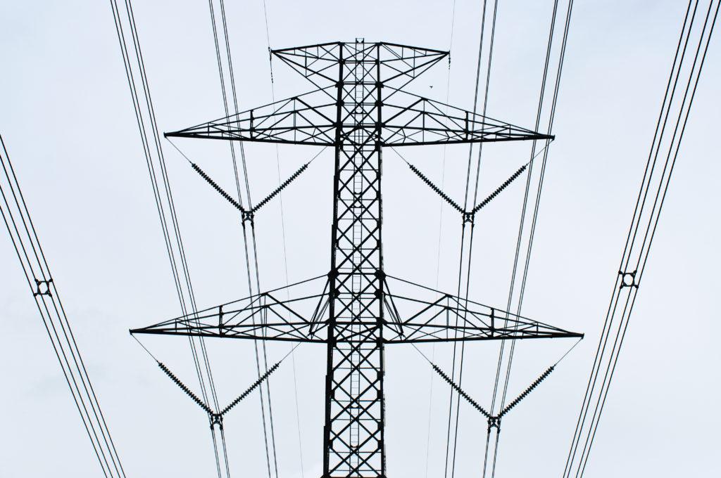 Electricity post on sky background