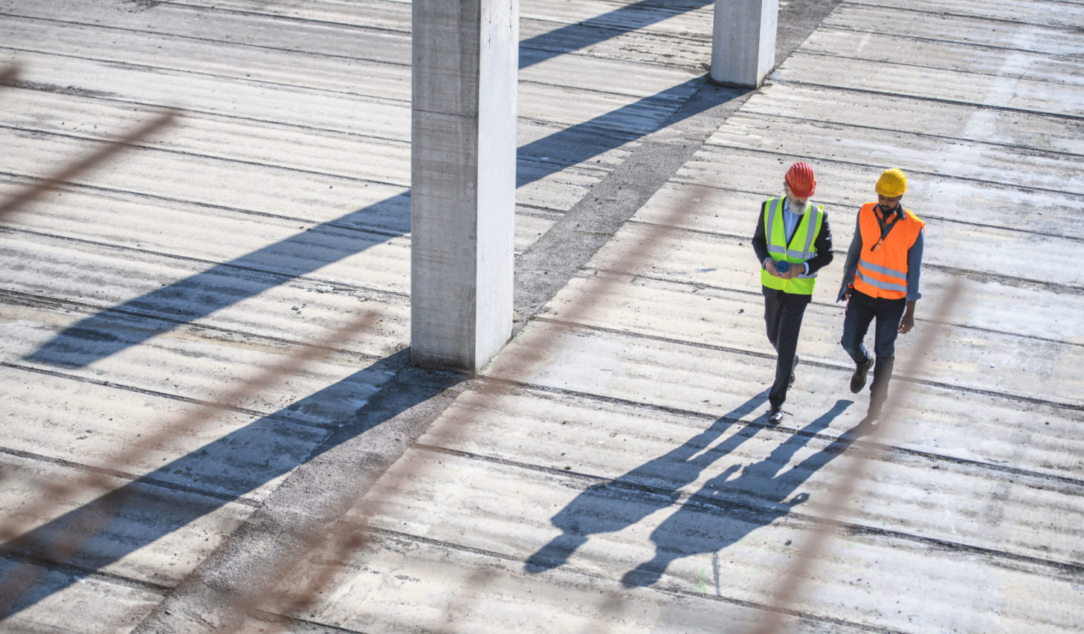 High Angle View of Construction Site Colleagues